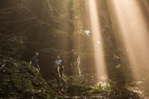 rays of sunlight shining down on hikers
