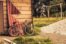 bike leaning against a garage