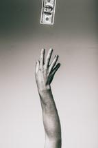 hand reaching for money