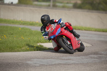 motorcycle taking a sharp turn
