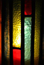 Stained glass candle shield.