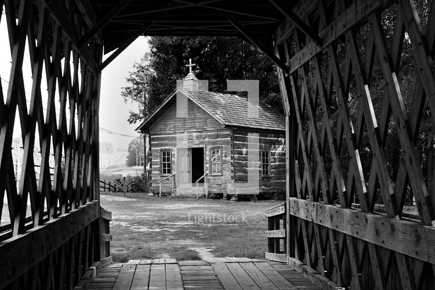covered bridge and old log cabin chapel