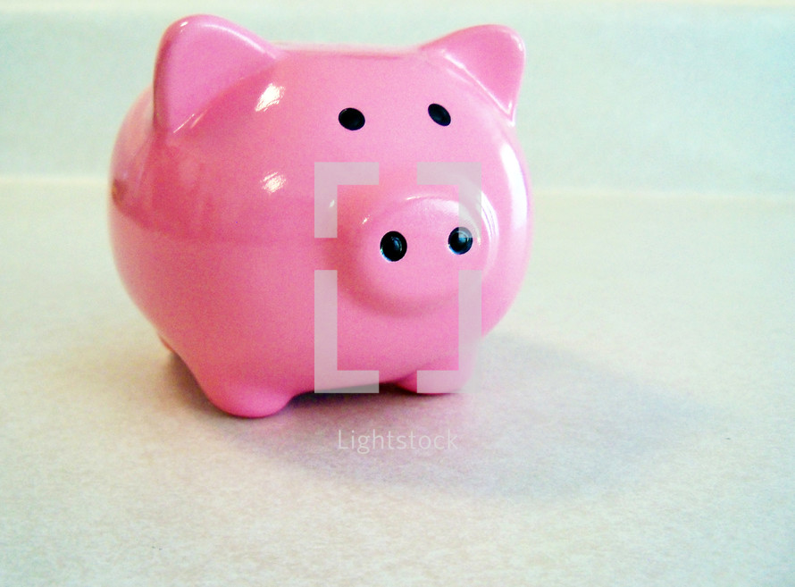 A bright pink colored piggy bank for saving coins for small children and adults who want to earn money on their savings, allowance money and earn interest. The Piggy bank is a universal symbol for savings and saving money so just wanted to share this fun image for use on blogs, websites, magazines, devotionals or any articles or advertisements that could use this image that everyone can identify with so easily.