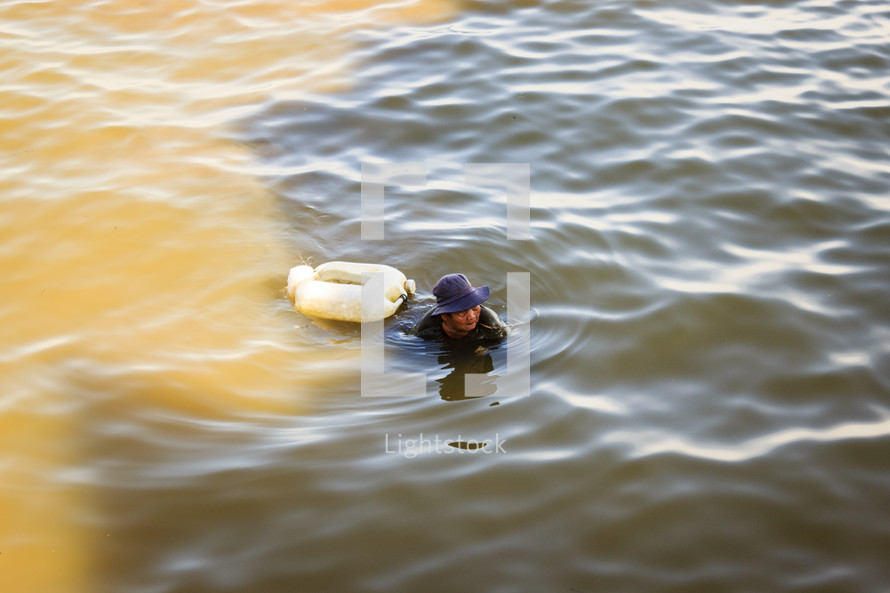man swimming in a lake