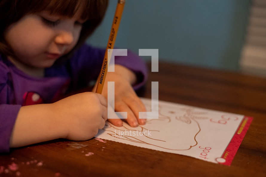 a preschool child learning