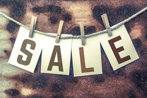 word sale on a clothesline