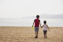 boys playing on a beach