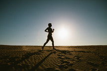 woman jogging in the sand