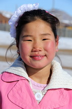 Smiling face of a Mongolian girl child