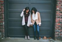 friends standing in front of a door looking down