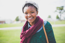 a smiling teenage girl in a scarf