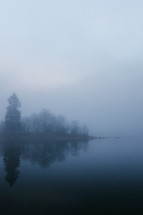 a lake in morning fog
