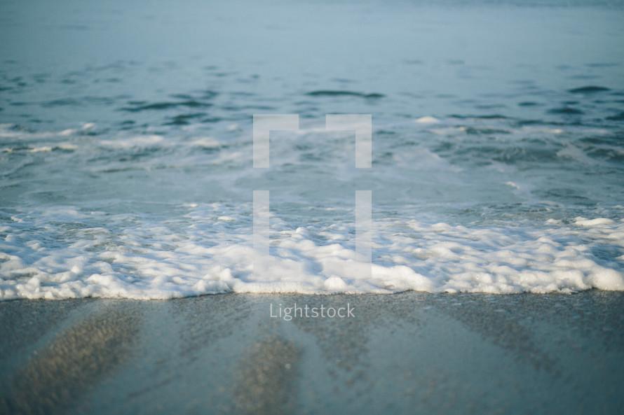 tide washing onto a beach