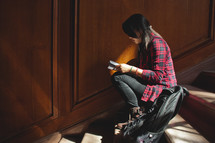 a young woman sitting in a stair well studying