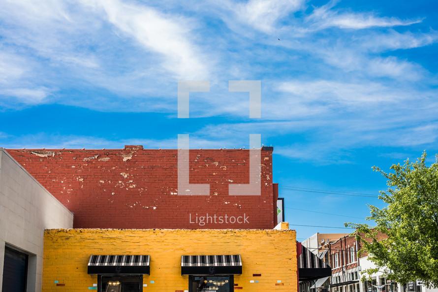 brick downtown building under a blue sky