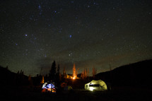 tents under a night sky full of stars