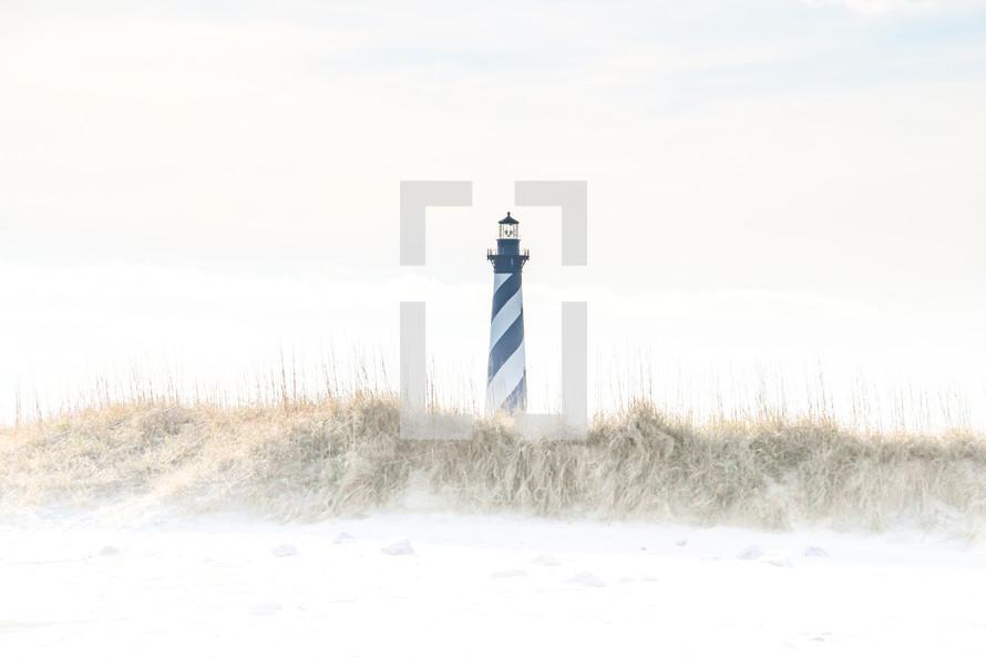 lighthouse and sandy beach