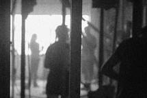Silhouettes of people at a work site.