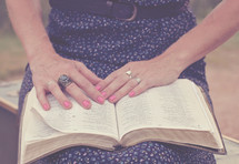 woman reading a Bible on her lap