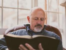 A man reading a Bible