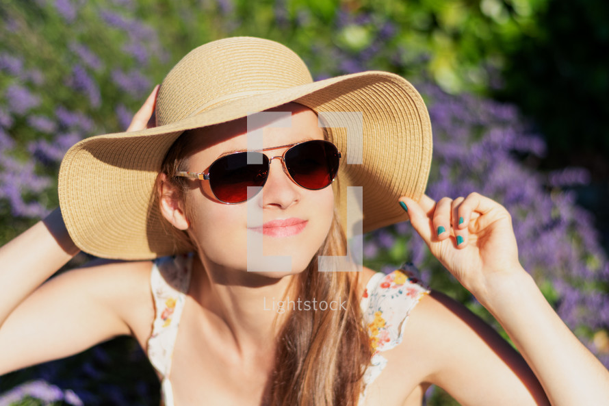 young woman in a sunhat