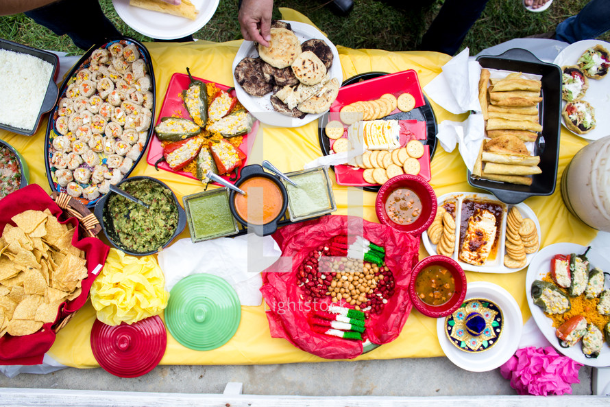 food and snacks on a table outdoors