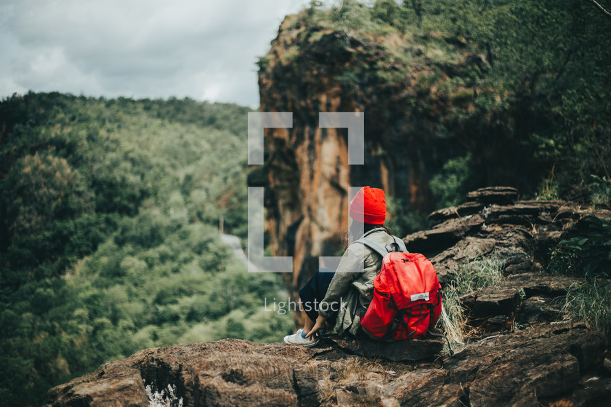 woman resting while backpacking through a forest