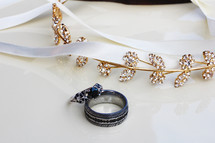 jewelry and ribbon on a white background
