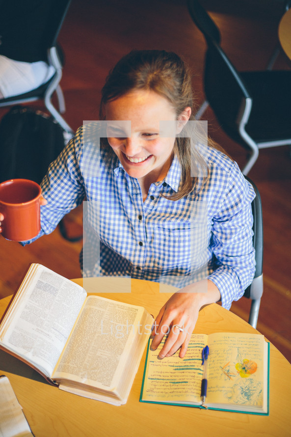 Woman drinking coffee at a Bible study.