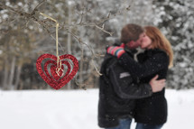 a couple kissing in snow
