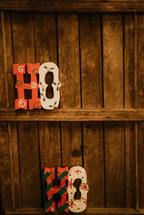 Ho Ho wooden decoration on shelves
