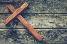 wooden cross on wood boards