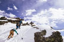 climbing up a snowy mountain