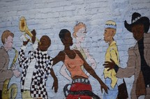 Jazz band and dancers street art painted on a brick wall