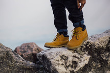 boots standing on rocks