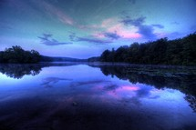 pink and purple clouds reflecting in lake water