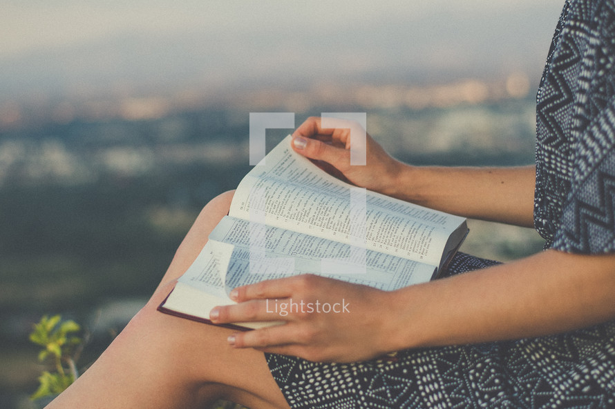a woman with a Bible in her lap
