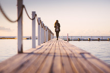 woman walking on a pier