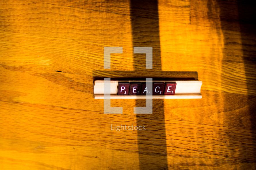 word peace in scrabble pieces