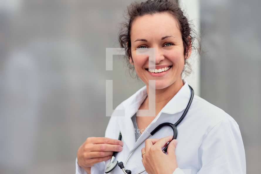 portrait of a female doctor in a lab coat