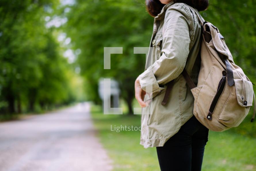 a girl waiting at a bus stop