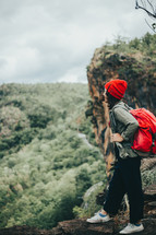 a woman backpacking through a forest