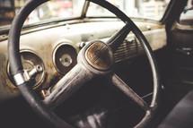vintage steering wheel in a car