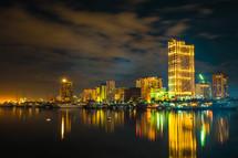boats and city lights at night