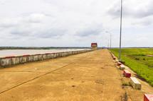 concrete wall and road along a coastline