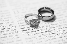 wedding band and engagement ring on the pages of a Bible
