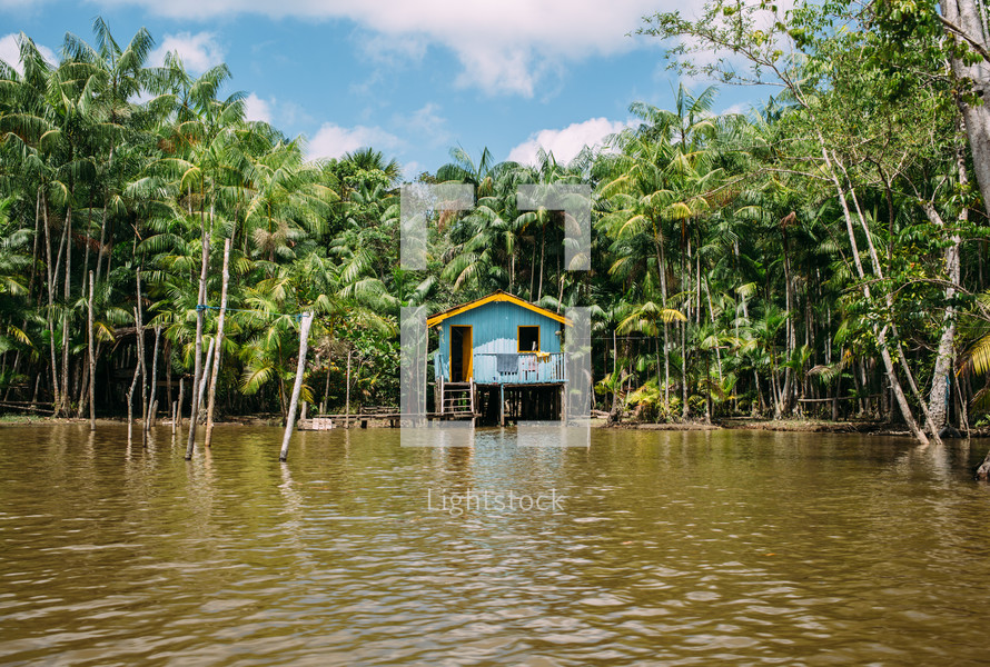a flooded hut along the edge of the Amazon river