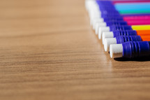 row of colorful pencils with erasers