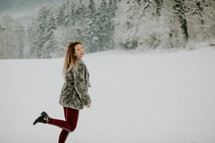 happy woman standing in snow