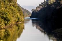 river between cliffs